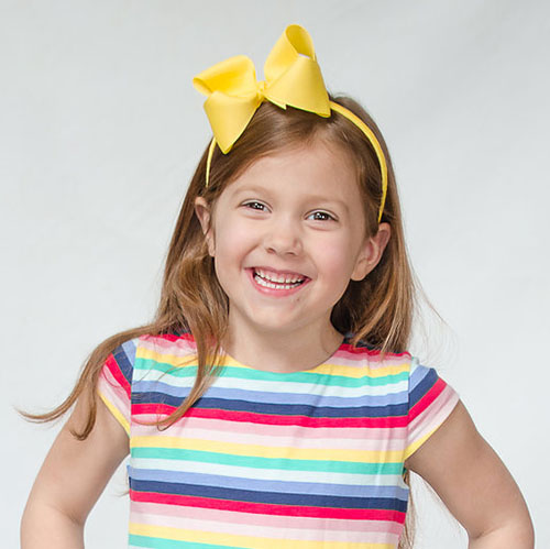 girl with yellow bow